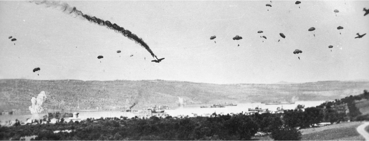 German paratroops parachuting onto the village of Suda. (AWM P00433.009)